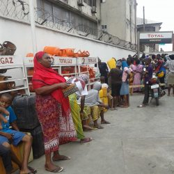 Consumers, predominantly women, queue for kerosene at Total filling station, Iponri, near Surulere, Lagos