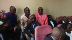 Evictees sit close to their counsel at FHC